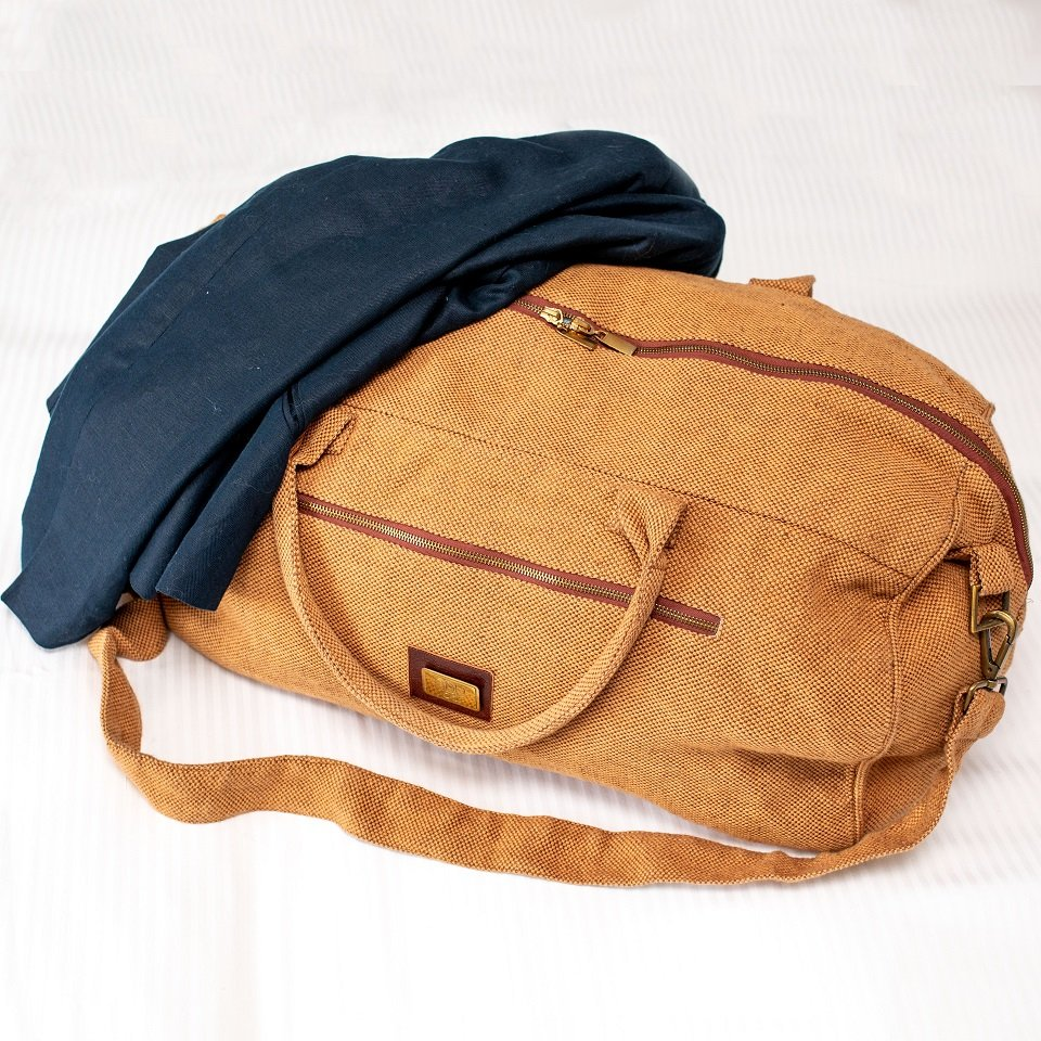 A canvas travel bag in ginger brown