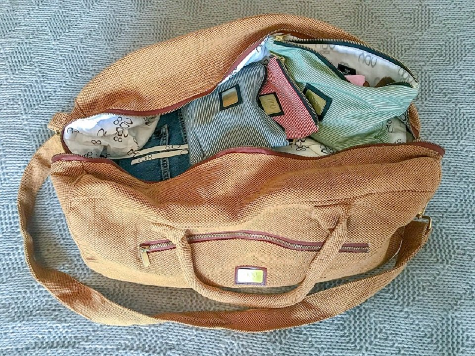 A packed unzipped travel bag