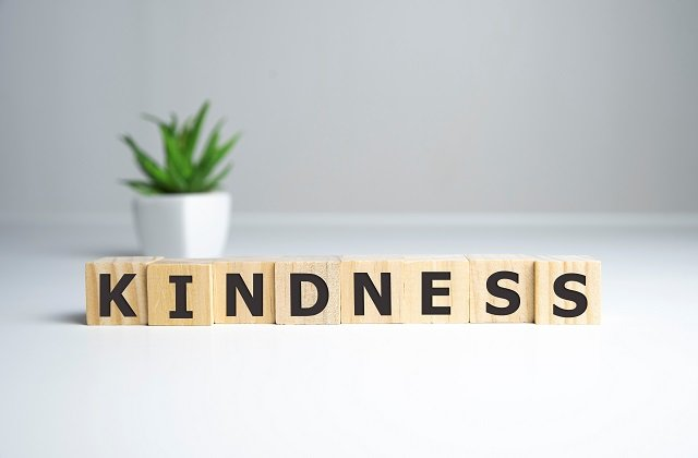KINDNESS – words from wooden blocks with letters, KINDNESS concept, top view background.