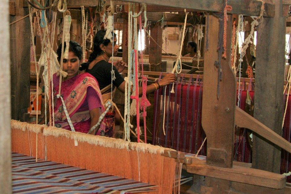 a girl behind a loom