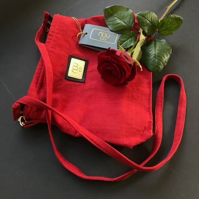 red esha bag and a rose